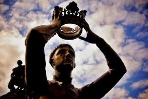 statue crown held over head